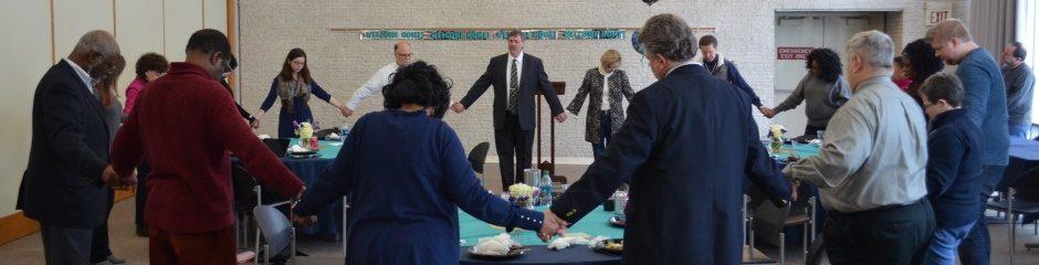 Staff members gather in prayer